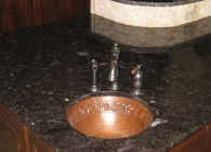 Antique Brown Counter with Copper Sink and Undulating Edge