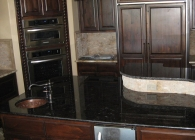 Antique Brown Granite Kitchen with Undulating Edge