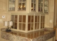 Typhoon Bordeaux Granite Ledge on a Crystal Cabinet