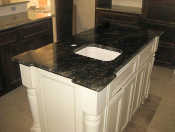 Granite kitchen countertops on white cabinets