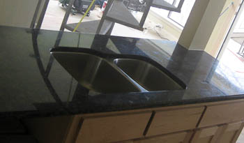 Undermount Sink in a Kitchen - this is a 60/40 sink with the smaller sink on the right