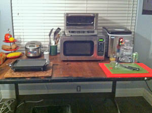 Makeshift kitchen with countertop appliances