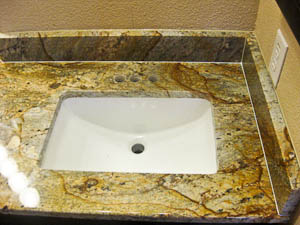 Rectangular undermount sink in a granite bathroom countertop