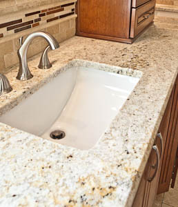 rectangular undermount sink in a granite bathroom countertop in Circle C in Austin