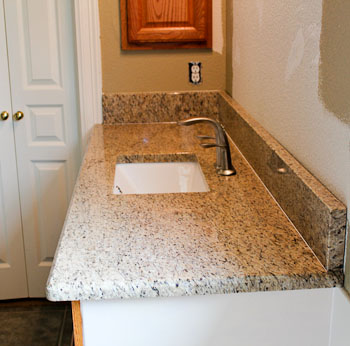 Ornamental Granite Vanity Top with Half inch Bevel Edge. Ornamental Granite Bathroom Vanities in Georgetown Texas