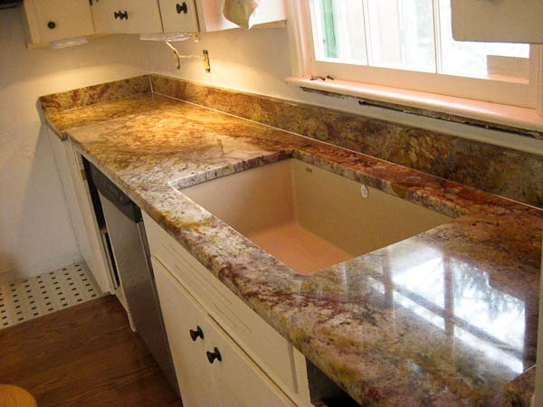 Typhoon Bordeaux Rustic granite with 4-inch granite backsplashes