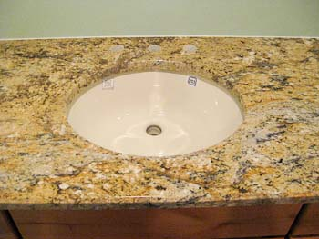 Yellow River Granite on pine cabinets