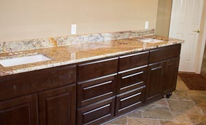 Cherry Master Bathroom Vanity Cabinets with a Granite Countertop