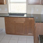 Peacock Green Granite L-Shaped Counter