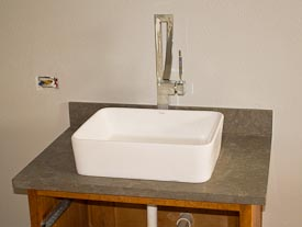 Kraus Vessel Sink on Limestone Counters with a Flat-Polish Edge