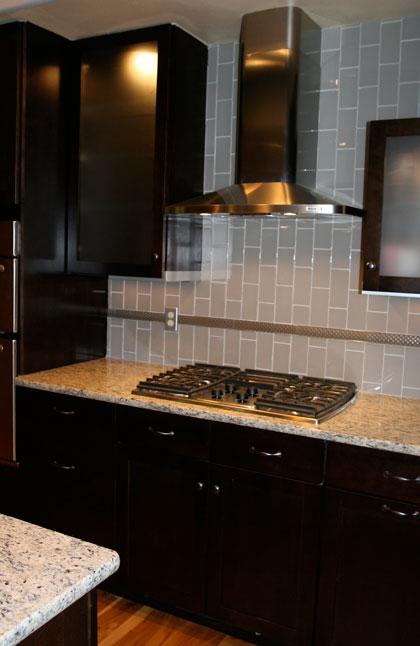Granite Kitchen Counter with Grey Glass Subway Tile Backsplash