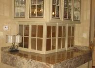 Typhoon Bordeaux Granite Ledge on a Crystal Cabinet