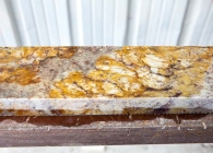 Typhoon Bordeaux Rustic Granite Backsplash