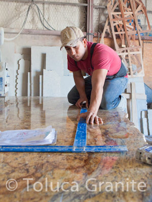 Laying out the cuts for Yellow River Granite