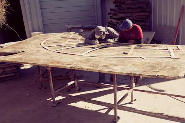 A huge granite kitchen island being laid out before cutting in Austin Texas