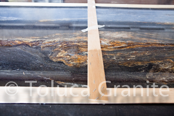 laying-out-cosmic-black-granite