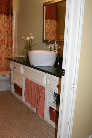 Uba Tuba granite bathroom vanity top in a bathroom remodel