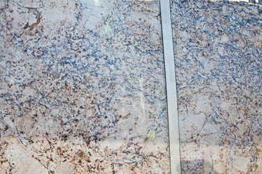 Exodus Granite - blue grey cream and gold at SGM in Austin.