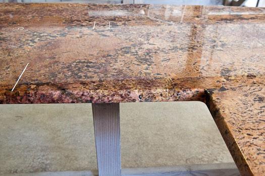 Polished-edge sink hole on Cabernet Bordeaux Granite