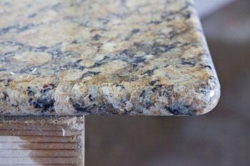 Full bullnose edge on Giallo Napoleon granite