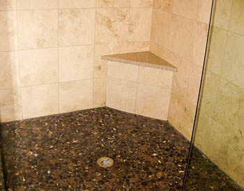 Granite Shower Seat with travertine tile walls