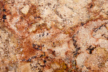 Red, rust and cream in a granite slab