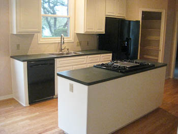 Westlake kitchen with white cabinets - before ornamental granite