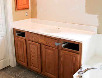 White Cultured Marble Vanity Top with Oak Cabinets