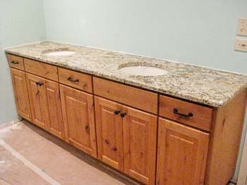 Yellow River Granite on custom pine cabinets