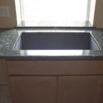 Granite Windowsill behind a large, single-bowl sink
