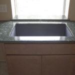 Granite Windowsill behind a large, single-bowl sink