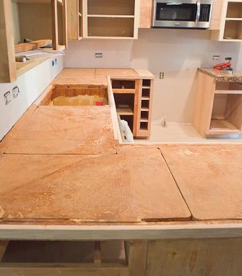 Particleboard subtop on old cabinets.